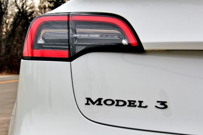 Model 3 Badge Emblem Black Rear Zoomed