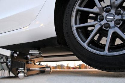 Model 3 lifted using a jack 3